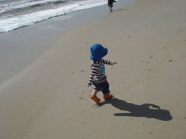 Photo of child walking on a beach