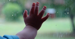 Baby Hand on Glass